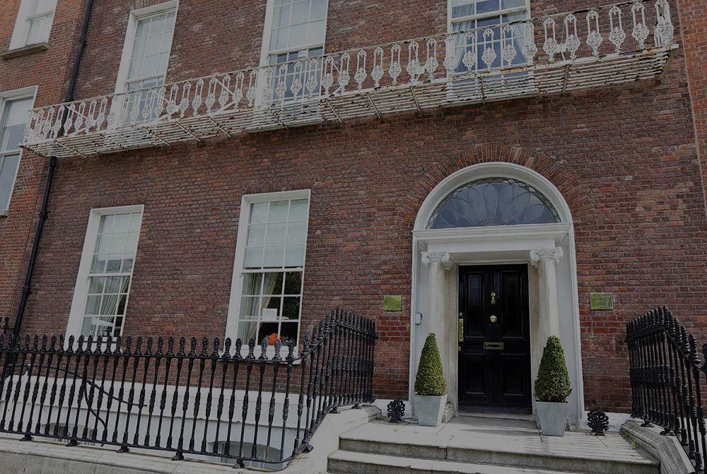 A colour image of the front door & elevation of 12 Merrion Square, Dublin 2. a Georgian serviced office building investment of Westhill