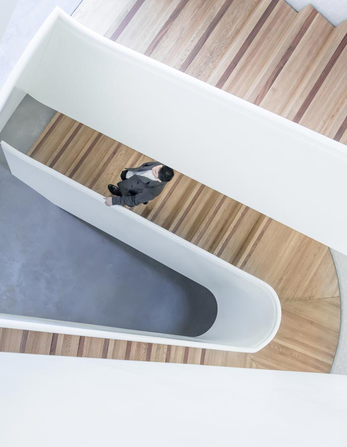 A colour image of a man walking down stairs representing the overview page of Westhill